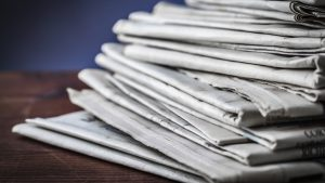 stack-newspaper-pile-cropped-1